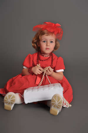 well-dressed little girl in red dress photo