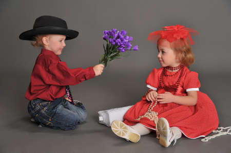 dance preteen: boy and girl in retro style in the studio