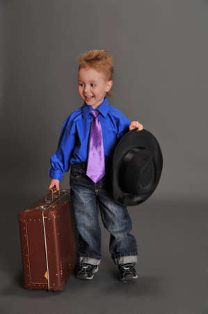 boy and an old suitcase photo