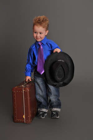 boy and an old suitcase Stock Photo - 10747209