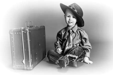 studio happy overall: boy and an old suitcase
