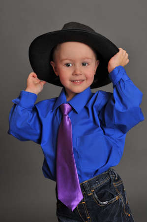 little boy in a hat and tie photo