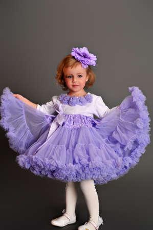 little girl dancing: Child wearing pettiskirt
