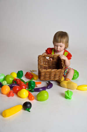 The little girl playing vegetables  photo