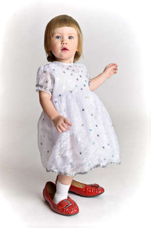 little girl trying on shoes Stock Photo - 10747472