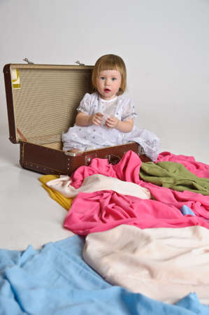 1 2 month: little girl and an old suitcase