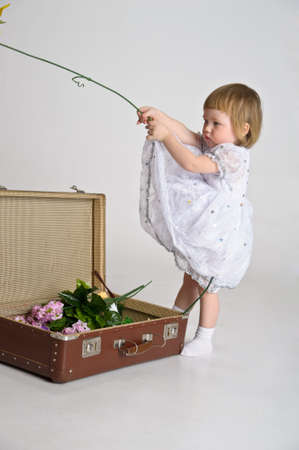 little girl and an old suitcase photo
