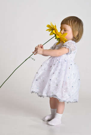 little girl with a sunflower photo