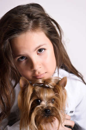 suited up: Girl with a Yorkshire Terrier Stock Photo
