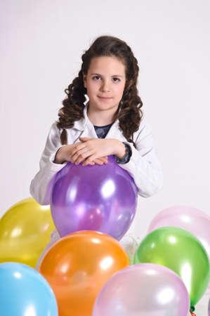 Girl among the balloons photo