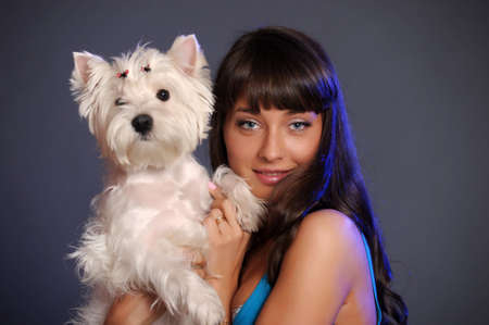 trusting: The young beautiful woman with a maltese
