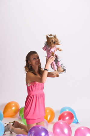 Girl with Yorkshire Terrier and balloons  photo