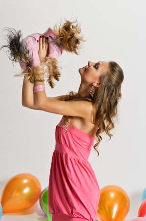 Humane: Girl with Yorkshire Terrier and balloons  Stock Photo