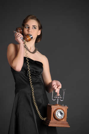 The young woman from a retro phone in hands Stock Photo - 11057132