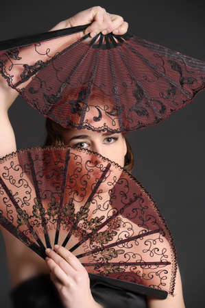 portrait of a girl with two fans Stock Photo - 9712197