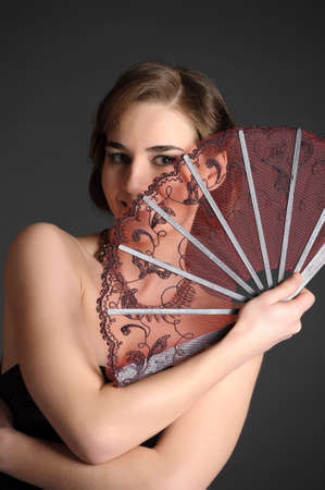 girl with a fan of retro style Stock Photo - 9712186