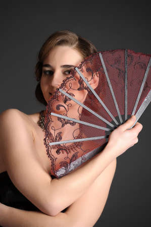 girl with a fan of retro style photo