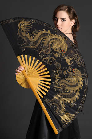 girl with a large fan Stock Photo - 10577113