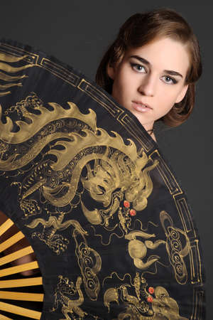 girl with a large fan Stock Photo - 10577103
