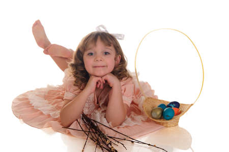 four year old: girl with a basket with Easter eggs