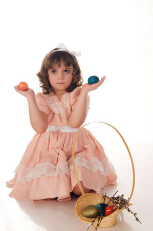 girl with a basket with Easter eggs photo