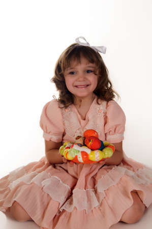 The little girl with easter eggs photo