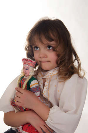 girl with a doll in a folk style photo
