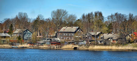 wooden village houses near the water. russia photo