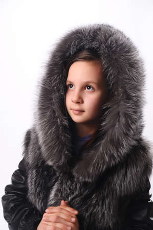 girl in a fur coat Stock Photo