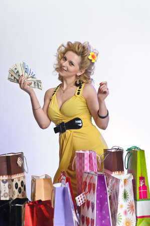 young woman with shopping and money Stock Photo - 10509863