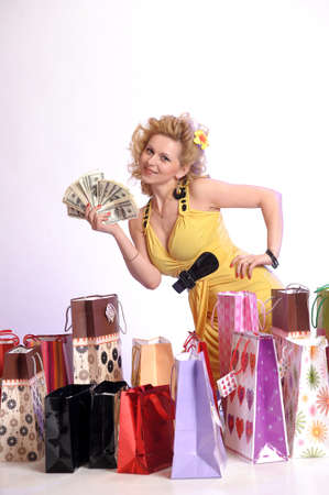 young woman with shopping and money Stock Photo - 10509855