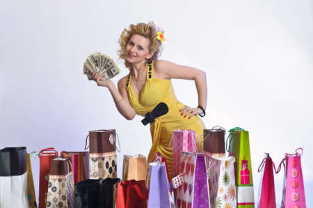 young woman with shopping and money Stock Photo - 10509859