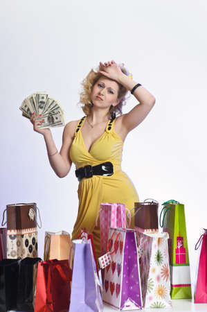 young woman with shopping and money Stock Photo - 10509853