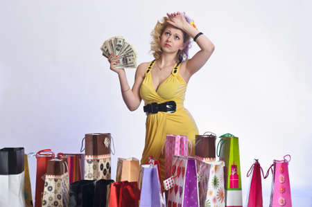 young woman with shopping and money Stock Photo - 10509854