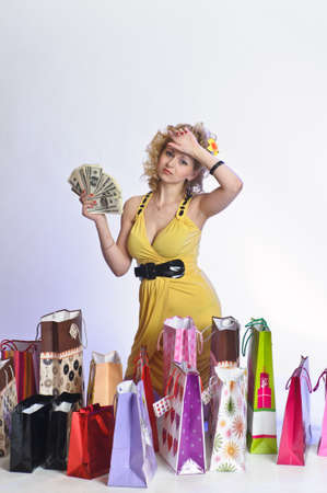 young woman with shopping and money Stock Photo - 10509851