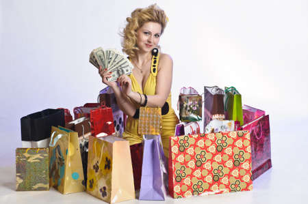young woman with shopping and money Stock Photo - 10509867