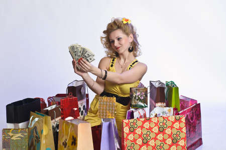 young woman with shopping and money photo