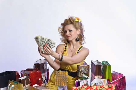 young woman with shopping and money Stock Photo - 10509850