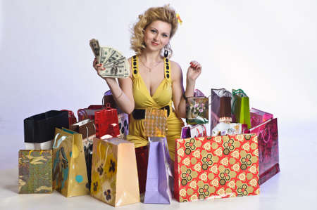 young woman with shopping and money Stock Photo - 10509866