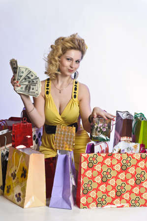 young woman with shopping and money Stock Photo - 10509886