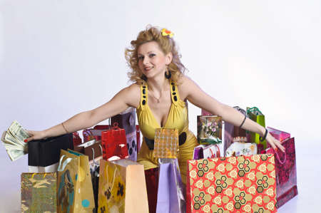 young woman with shopping and money Stock Photo - 10509888