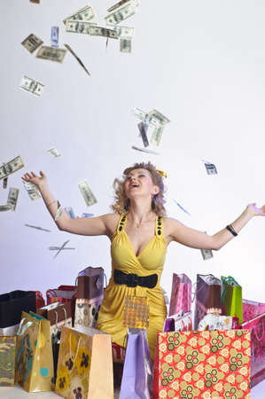 young woman with shopping and money Stock Photo - 10509880