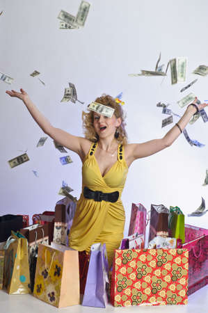 young woman with shopping and money Stock Photo - 10509883