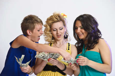 girls with money  in their hands Stock Photo - 10584443