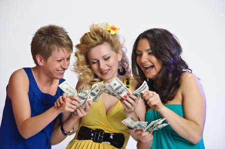 girls with money  in their hands Stock Photo - 10584447