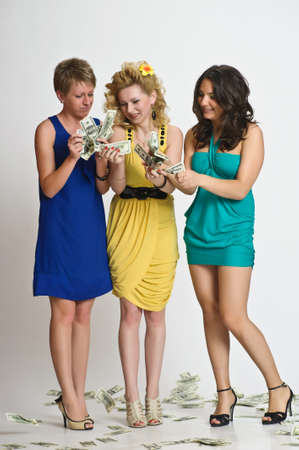 two dollar bill: girls with money  in their hands Stock Photo