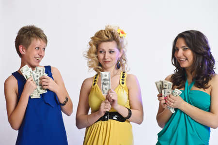 assumed: girls with money  in their hands Stock Photo