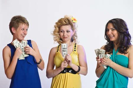 niñas con dinero en sus manos Foto de archivo - 10584440