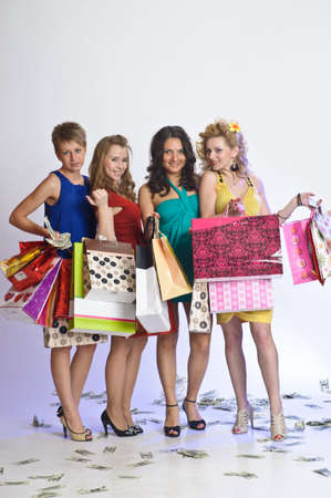 four friends after shopping Stock Photo - 10578234