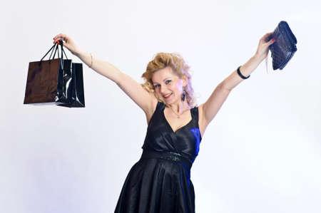 happy young woman buying a new handbag Stock Photo - 10747550
